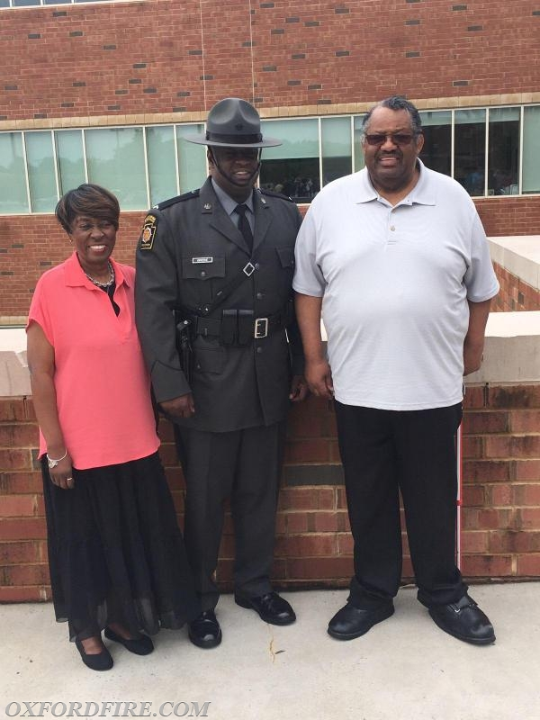 Corporal Greene with his Parents.